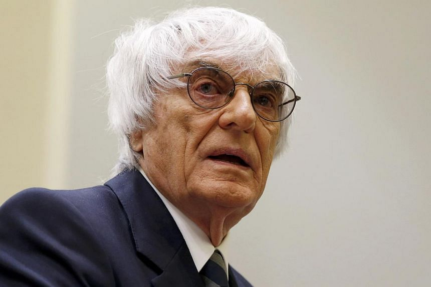 Formula One chief executive Bernie Ecclestone arrives for the third day of his trial in the regional court in Munich on May 9, 2014. -- PHOTO: REUTERS