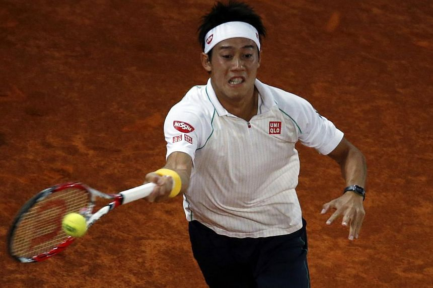 Kei Nishikori of Japan returns a forehand to Feliciano Lopez of Spain during their match at the Madrid Open tennis tournament on May 9, 2014. -- PHOTO: REUTERS