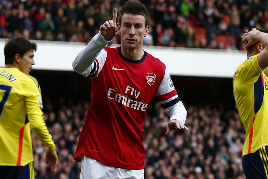 """Arsenal's Laurent Koscielny celebrates his goal against Sunderland during their English Premier League soccer match at the Emirates Stadium in London on Feb 22, 2014. Koscielny has signed a """"new long-term contract"""" at the Emirates, the Premier League"""