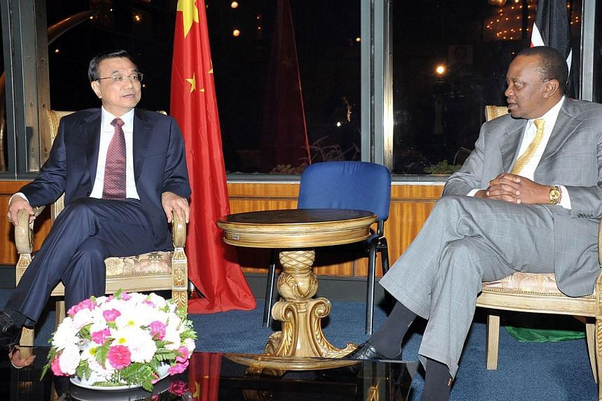 Kenyan President Uhuru Kenyatta meets with Chinese Prime Minister Li Keqiang upon his arrival in Nairobi, at the presidential pavillion of Jomo Kenyatta International Airport on May 08, 2014. -- FILE PHOTO: AFP