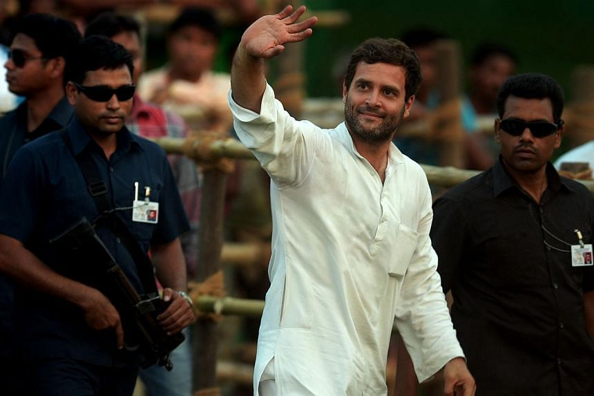 Indian Congress Party Vice President Rahul Gandhi greets supporters at an election rally in Kolkata on May 8, 2014.India's election commission charged Rahul Gandhi with breaching its code of conduct Friday after the ruling Congress party's fron