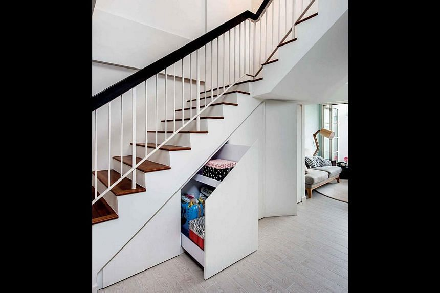 Turn the area under the stairs into tiered storage to keep things neat and tidy at home.