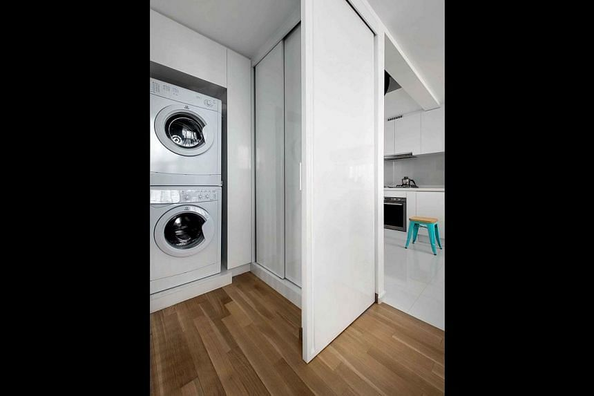 In this home (above), design firm The Interarch Design carved out a tall but shallow sliding-door cabinet next to the laundry area, which can store tall and flat items. -- PHOTO: EDWARD HENDRICKS, CI&A; DESIGN: THE INTERARCH DESIGN
