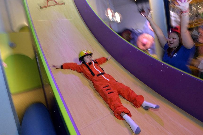 Some of the highlights of KidsSTOP are (from top): a 7m slide for kids to learn about gravity, a sandpit where they can get a feel for being palaeontologists and a flight simulator for budding pilots.