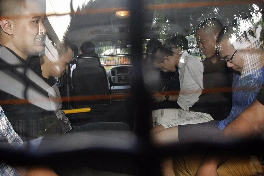 Five teenagers, arrested in connection with the high-rise vandalism at the rooftop of a Toa Payoh HDB block on Wednesday, were charged for the offence on Saturday. -- ST PHOTO: KEVIN LIM
