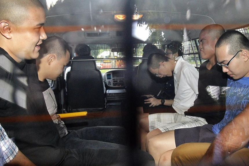 Police have arrested five 17-year old youths for suspected involvement in a case of vandalism that had occurred at Blk 85A Lorong 4 Toa Payoh. They arrive at the State Courts on May 10, 2014, to be charged. -- ST PHOTO: KEVIN LIM
