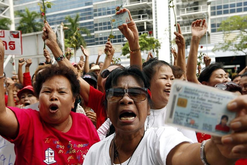 Members of pro-government group Red Shirt attend a rally to support former Prime Minister Yingluck Shinawatra (not in picture) after she was removed from office at the Office of the Permanent Secretary for Defense in Bangkok, Thailand, May 7, 2014. -