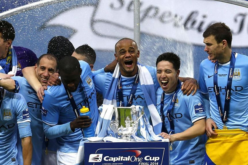 League Cup winners Manchester City need just a draw tomorrow at home to secure the double. -- PHOTO: REUTERS
