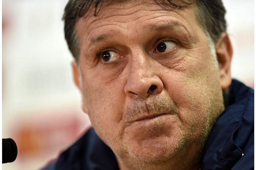 Barcelona coach Gerardo Martino does not believe the club owe him an apology after sporting director Andoni Zubizarreta was filmed this week meeting Celta Vigo coach and former Barca player Luis Enrique. -- FILE PHOTO: AFP