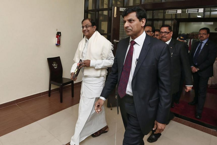 India's Finance Minister Palaniappan Chidambaram (L) and Reserve Bank of India (RBI) Governor Raghuram Rajan (2nd L) at New Delhi.--PHOTO: REUTERS