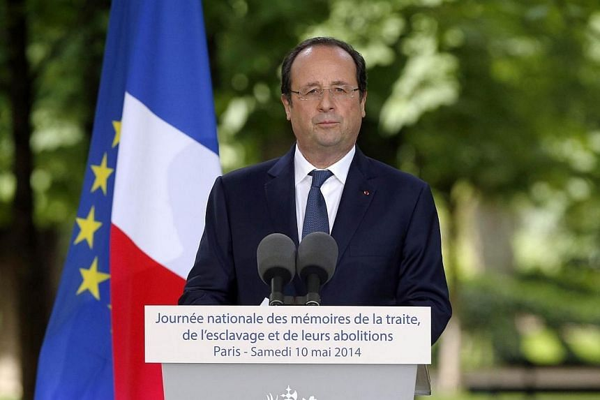 French President Francois Hollande delivers a speech as he attends a ceremony on May 10, 2014 at the Luxembourg Gardens in Paris to mark the abolition of slavery and to pay tribute to the victims of the slave trade.French President Francois Hol