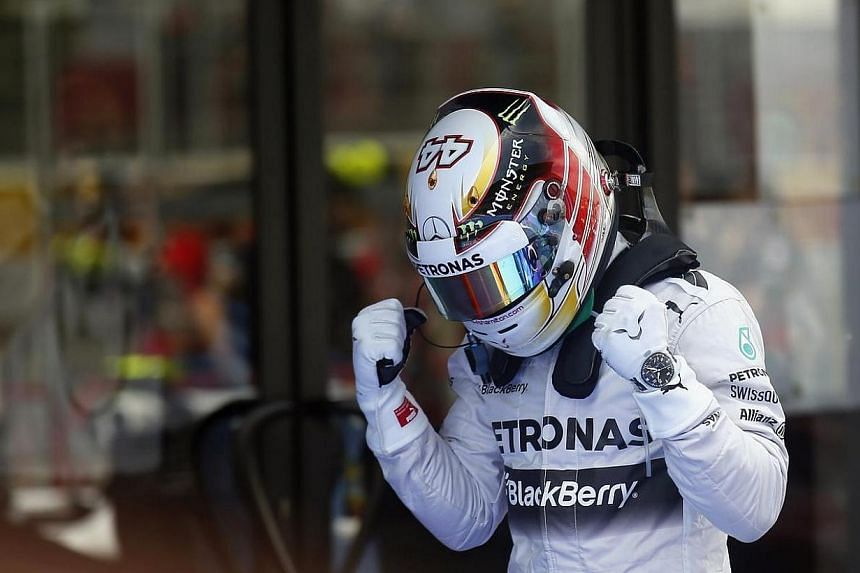 Mercedes Formula One driver Lewis Hamilton of Britain celebrates after taking the pole position at the qualifying session of the Spanish F1 Grand Prix at the Barcelona-Catalunya Circuit in Montmelo on May 10, 2014.-- PHOTO: REUTERS