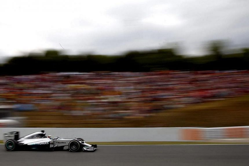 British driver Lewis Hamilton of Mercedes steers his car during Spain's Formula One Grand Prix at Catalunya racetrack in Montmelo, Barcelona province, Catalonia, north-eastern Spain on May 11, 2014. -- PHOTO: EPA