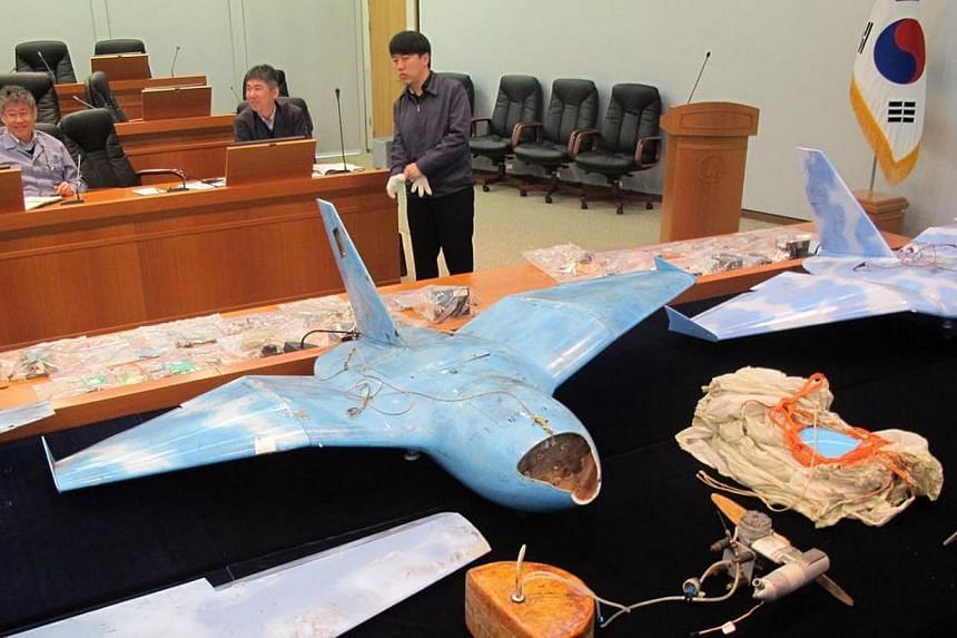 This handout photo taken on April 11, 2014 and released by South Korean Defence Ministry shows wreckage of three unmanned aerial vehicles found in three different places, including Baengnyeong island near the rivals' disputed sea border, at the Agenc