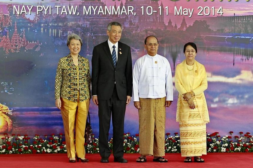 (From left)Madame Ho Ching, Singapore Prime Minister Lee Hsien Loong, Myanmar President Thein Sein and his wife Khin Khin Win pose for the photo before the opening ceremony of the 24th Association of Southeast Asian Nations (ASEAN) Summit in Na