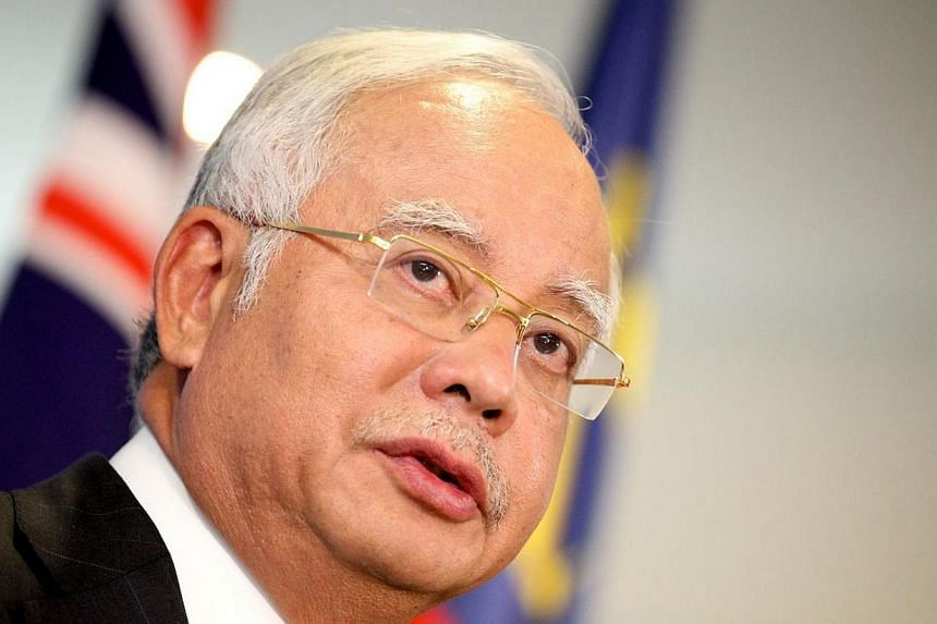 Prime Minister Najib Razak said his patience should not be interpreted as a weakness, and added that he believes Malaysians want more space to debate issues without fear of being arrested. -- FILE PHOTO: AFP