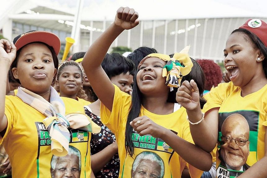 African National Congress (ANC) supporters celebrate during the victory celebrations of the ANC at the Peoples Park outside the Moses Mabhida Football stadium in Durban on May 10, 2014.South Africa's ruling ANC vowed on Sunday, May 11, 2014, to