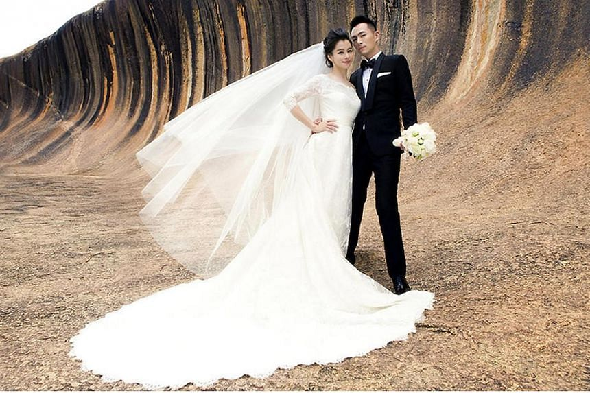 Taiwan singer Vivian Hsu has posed in a series of romantic bridal shots with Singapore-based businessman Sean Lee in various places such as Wave Rock, ahead of their Bali wedding next month. -- PHOTO: MUSICMOVEMENT.COM.SG