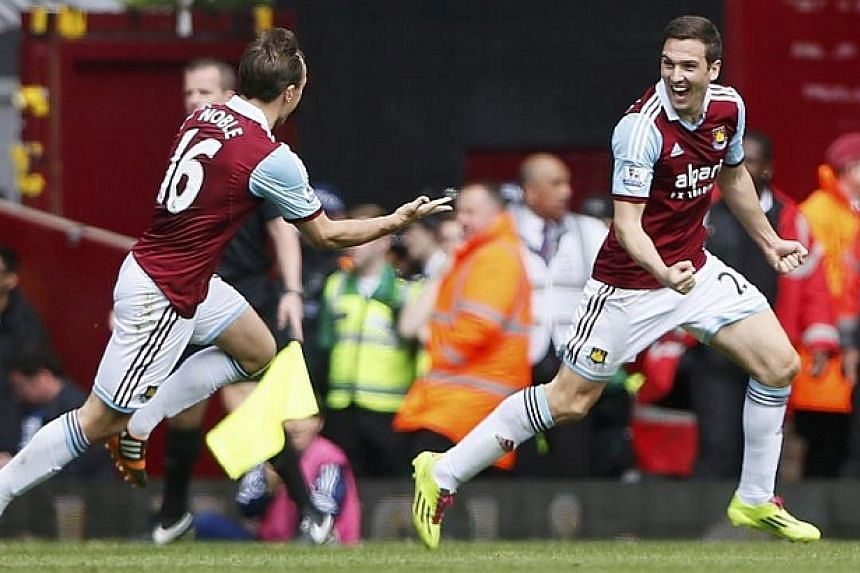 Stewart Downing (right) of West Ham United celebrates scoring against Tottenham Hotspur during their English Premier League soccer match at Upton Park in London on May 3, 2014. The last time West Ham beat Manchester City in the league was in 200