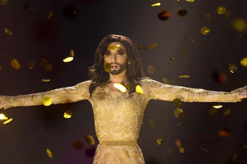 "Conchita Wurst representing Austria performs the song ""Rise Like A Phoenix"" after winning the Eurovision Song Contest 2014 Grand Final in Copenhagen, Denmark, on May 10, 2014. -- PHOTO: AFP"
