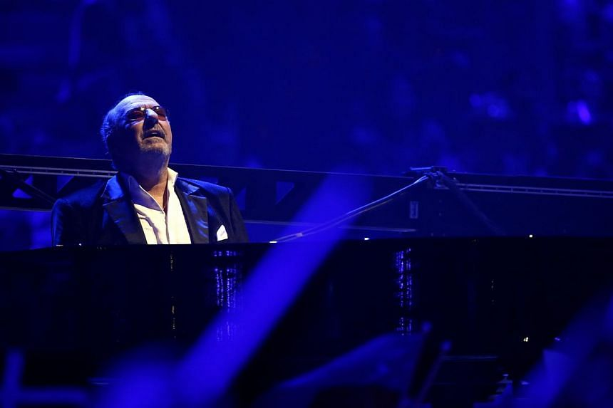 Ralph Siegel, German composer and songwriter plays piano during the performance of Singer Valentina Monetta representing San Marino singing the song Maybe (Forse) during the grand final of the 59th Eurovision Song Contest at the B&W Hallerne in C