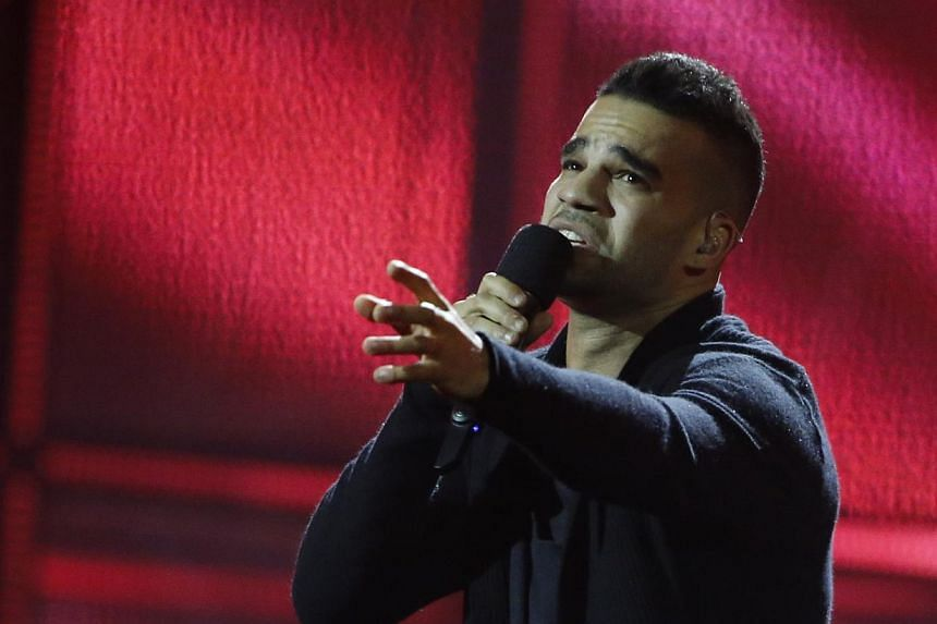 Singer Andras Kallay-Saunders representing Hungary performs the song Running during the grand final of the 59th Eurovision Song Contest at the B&W Hallerne in Copenhagen on May 10, 2014. -- PHOTO: REUTERS