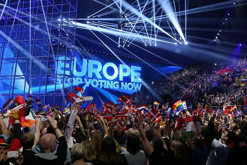 Fans wait for the beginning of the Grand Final of the 59th annual Eurovision Song Contest (ESC) at the B&W Hallerne in Copenhagen, Denmark, on May 10, 2014. -- PHOTO: EPA