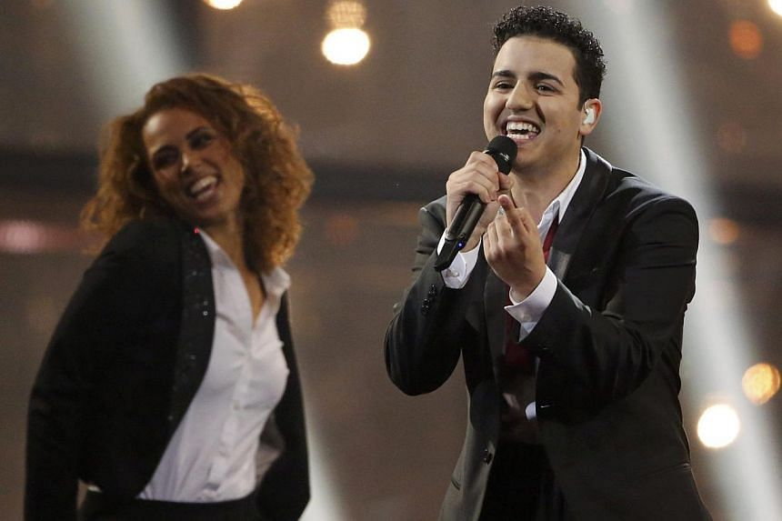 Singer Basim representing Denmark performs the song Cliche Love Song during the grand final of the 59th Eurovision Song Contest at the B&W Hallerne in Copenhagen on May 10, 2014. -- PHOTO: REUTERS