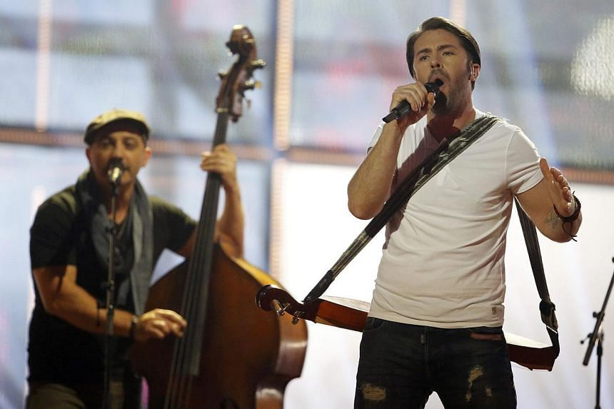 Firelight representing Malta performs the song Coming Home during the grand final of the 59th Eurovision Song Contest at the B&W Hallerne in Copenhagen on May 10, 2014. -- PHOTO: REUTERS