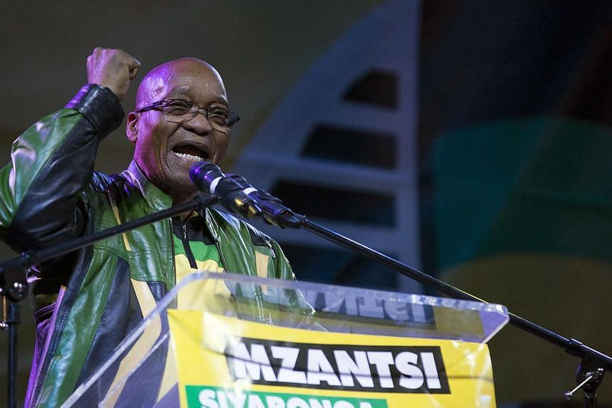 South African President Jacob Zuma celebrates the African National Congress victory in the national election in Johannesburg on May 10, 2014. -- PHOTO: AFP