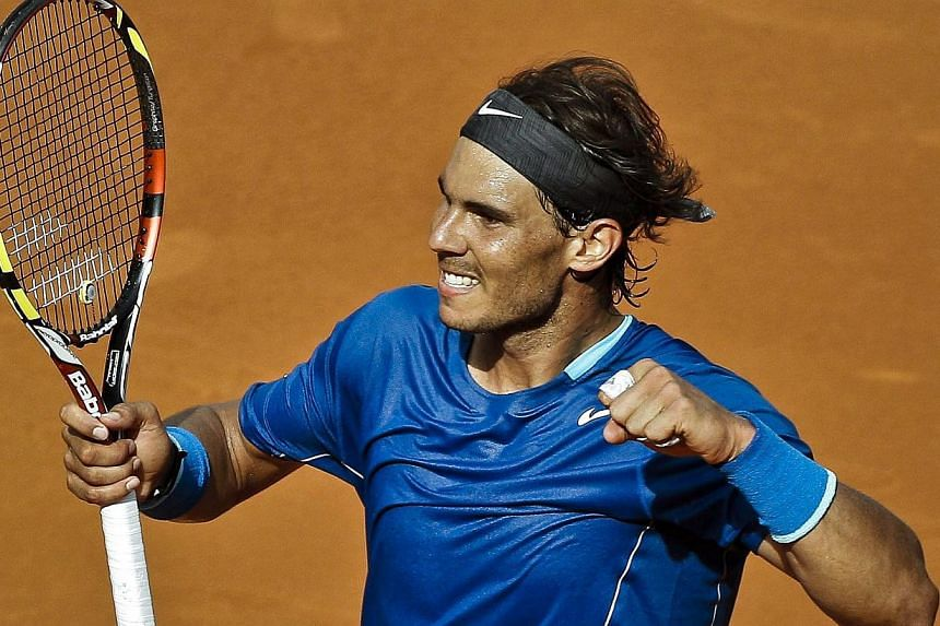 Rafael Nadal of Spain celebrates winning against Roberto Bautista Agut of Spain in their semi-final match for the Mutua Open Madrid Masters 1000 tennis tournament in Madrid, Spain, on May 10, 2014. -- PHOTO: EPA