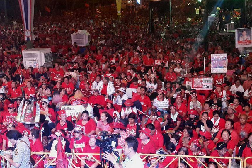 Pro-Yingluck red shirts gathered at the edge of Bangkok on Saturday night.-- PHOTO: NIRMAL GHOSH