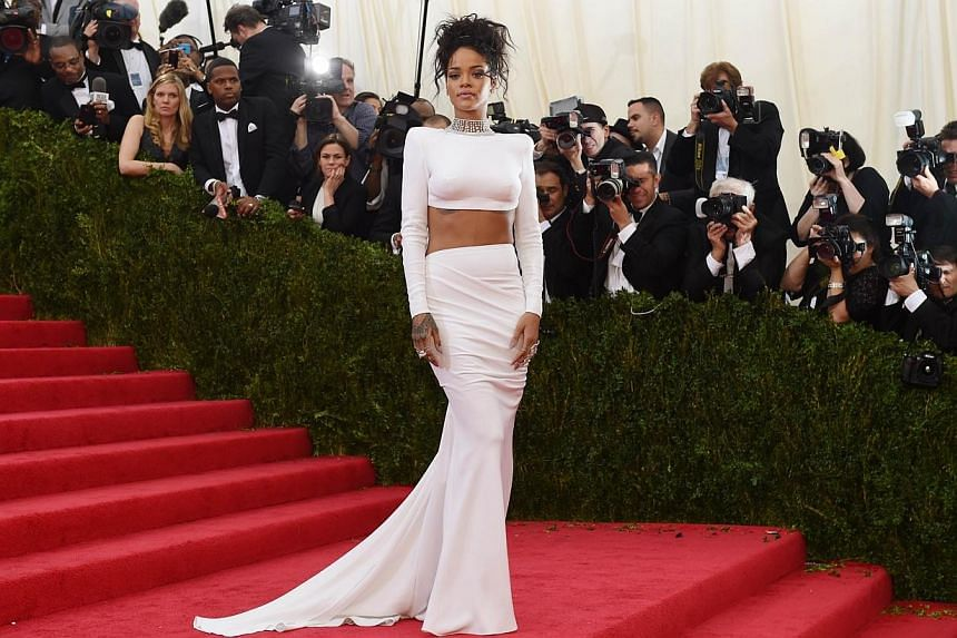 Rihanna arrives at the Costume Institute Benefit at The Metropolitan Museum of Art May 5, 2014 in New York. -- FILE PHOTO: AFP