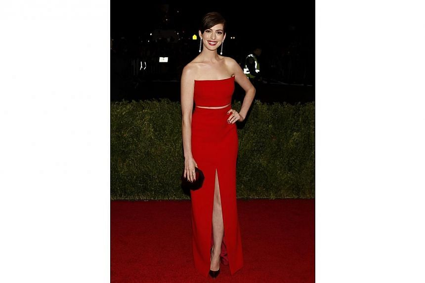 "Actress Anne Hathaway arrives at the Metropolitan Museum of Art Costume Institute Gala Benefit celebrating the opening of ""Charles James: Beyond Fashion"" in Upper Manhattan, New York May 5, 2014. -- FILE PHOTO: REUTERS"