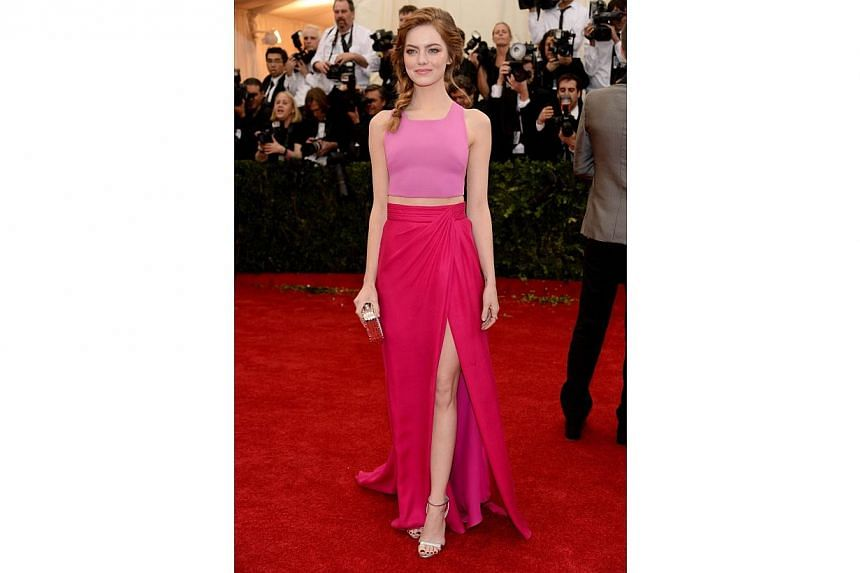 "Emma Stone attends the ""Charles James: Beyond Fashion"" Costume Institute Gala at the Metropolitan Museum of Art on May 5, 2014 in New York City. -- FILE PHOTO: AFP"