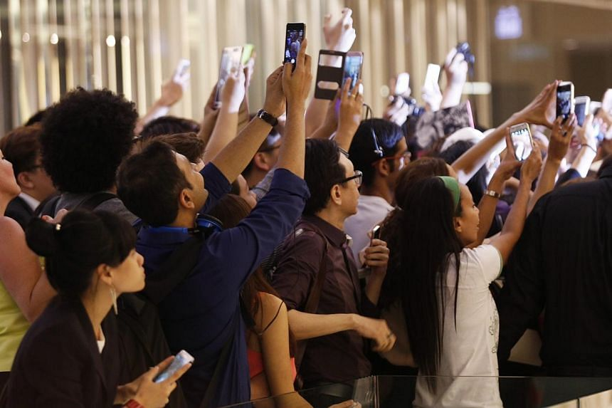 More than 100 well-heeled women jostled for a chance to snap a picture of themselves with British celebrity designer Victoria Beckham, better known as Posh Spice, at a private event on the evening of May 12, 2014. -- PHOTO: DESMOND LUI