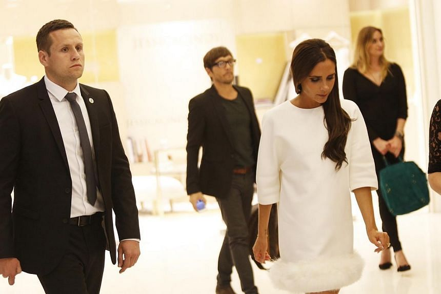Victoria Beckham, as photographed during the launch of her accessory line for On Pedder at Scotts Square on 12 May 2014.More than 100 well-heeled women jostled for a chance to snap a picture of themselves with British celebrity designer Victori