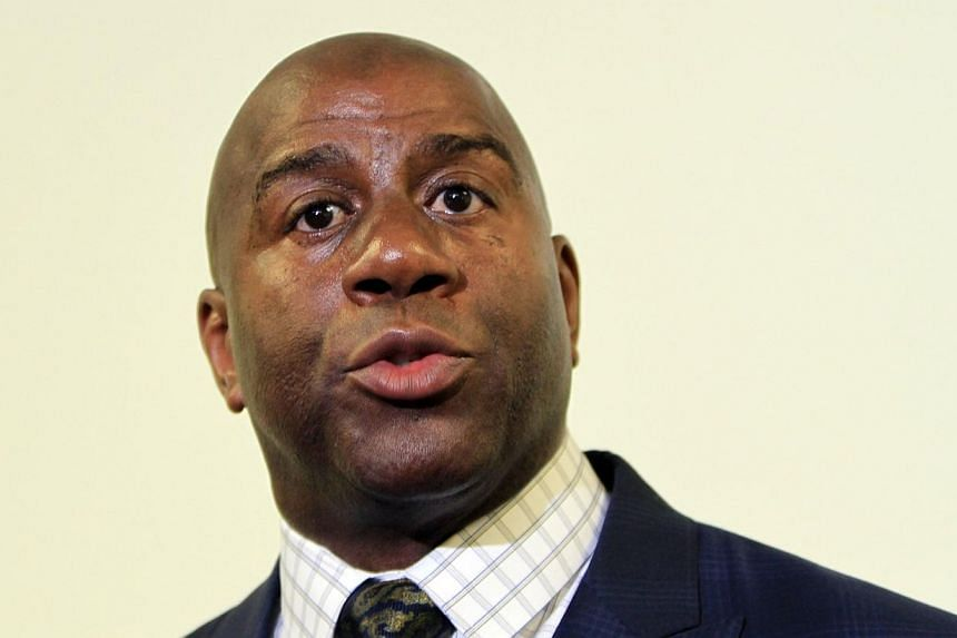 "Hall of Famer Earvin ""Magic"" Johnson on Sunday reiterated his belief that the National Basketball Association (NBA) must oust embattled Los Angeles Clippers owner Donald Sterling, and said players will not play for his wife, Shelly, either. -- FILE P"