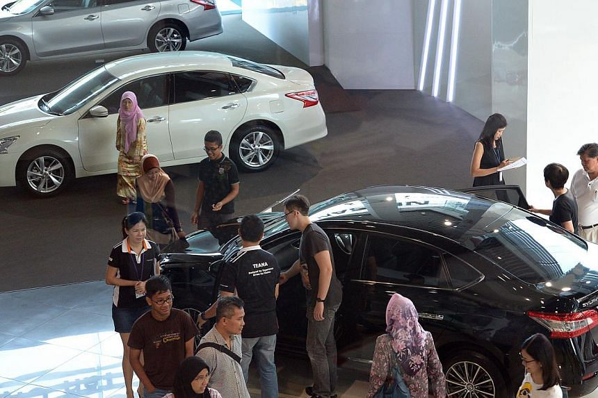 Potential buyers at the Nissan showroom in Ubi Road on Saturday, after the unexpected fall in COE premiums last week.