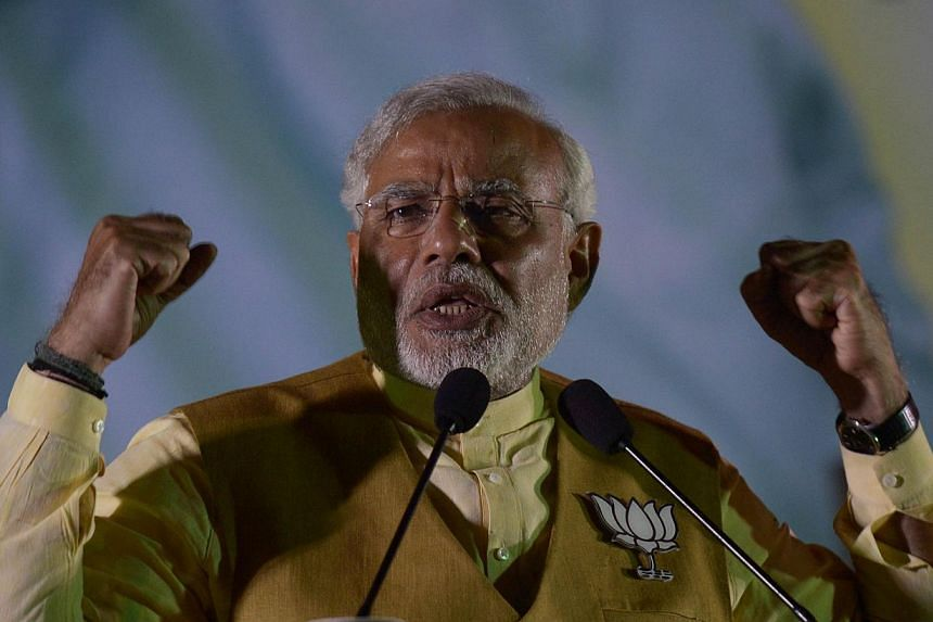 Chief Minister of the western Indian state of Gujarat and India's main opposition Bharatiya Janata Party (BJP) prime ministerial candidate Narendra Modi gestures as he speaks during a campaign rally in Kolkata on May 7, 2014. -- PHOTO: AFP