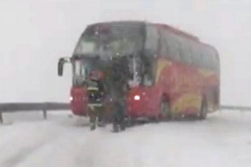 More than 90 Singaporeans were trapped in a snowstorm for more than three hours on Sunday, after their bus got stuck in snow on Mount Wutai in China's Shanxi province. The tourists, many of them elderly, had to wait in temperatures as low as minus 15
