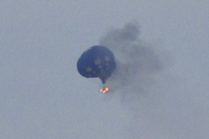 Witnesses watched in horror last Friday as the balloon caught fire in the evening sky after hitting a power line as it was coming down into a pre-designated field near the state capital Richmond. -- FILE PHOTO: REUTERS/LYNN SHULTZ