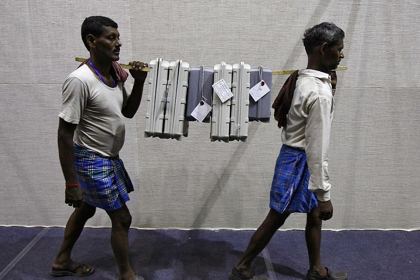 Electronic voting machines being carried to an election material distribution centre on the eve of the final phase of general election in Kolkata on May 11, 2014. -- FILE PHOTO: REUTERS
