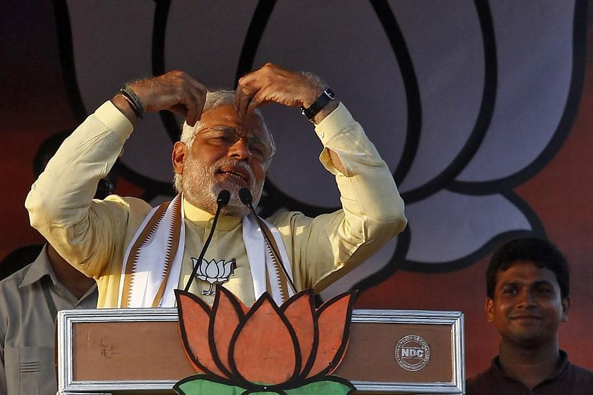 Hindu nationalist Narendra Modi (front left), the prime ministerial candidate for India's main opposition Bharatiya Janata Party (BJP), gestures as he addresses an election campaign rally in Barasat, north of Kolkata on May 7, 2014. India's oppositio
