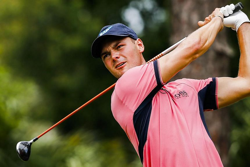 Martin Kaymer of Germany hits his tee shot on the second hole during the fourth round of The Players Championship on the Stadium Course at TPC Sawgrass in Ponte Vedra Beach, Florida, USA on May 11, 2014. Kaymer survived a late double-bogey to win the