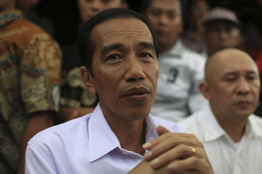 """Indonesian presidential frontrunner Joko """"Jokowi"""" Widodo's plan to slowly reduce fuel subsidies over the next few years is the best option to ease pressure on the budget deficit while keeping inflation in check, economists said. -- FILE PHOTO: REUTER"""
