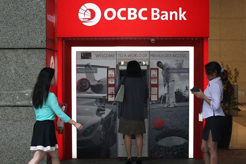 The new function on the updated OCBC Mobile Banking app allows its e-banking customers to send up to $100 to any Facebook friend without needing the recipient's bank account details. -- ST FILE PHOTO: KEVIN LIM