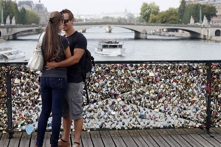 A massive number of padlocks hitched by lovers on the Pont des Arts. -- FILE PHOTO: AFP