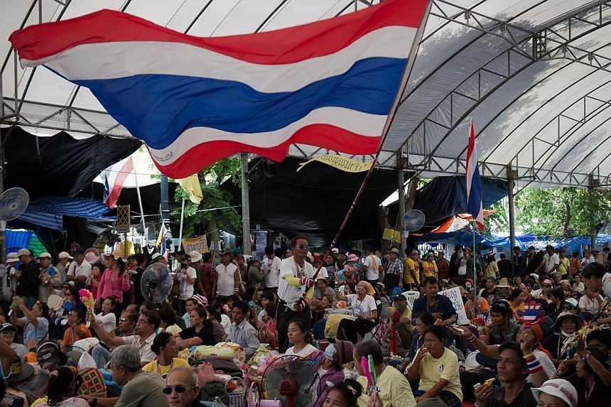 Anti-government protesters rally at Government House in Bangkok on May 11, 2014. -- PHOTO: AFP