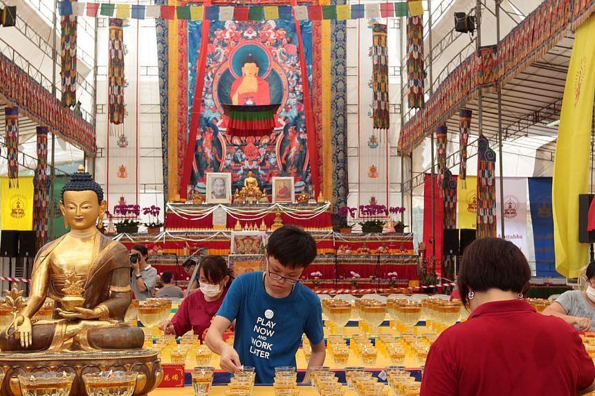 Amitabha Buddhist Centre puts up a 50ft thangka, or tapestry, depicting Amitabha Buddha with the Eight Great Bodhisattvas to mark Vesak Day. -- ST FILE PHOTO: NEO XIAOBIN